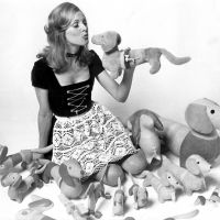 Uschi Badenberg poses with a soft toy collection of the Olympic Games 1972 mascot Waldi, 1971. Foto Hollandse Hoogte / dpa Olympia
