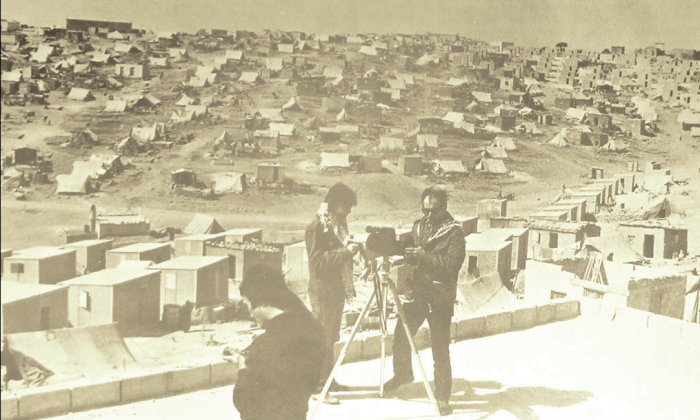"""Gorin and Godard shooting 'Until Victory', """"the film undertaken...at the request of the PLO"""", in a Palestinian refugee camp, Jordan, 1970. Photographer unknown."""